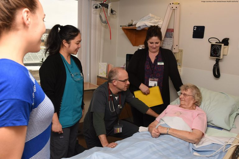 ACU care team at bedside with patient
